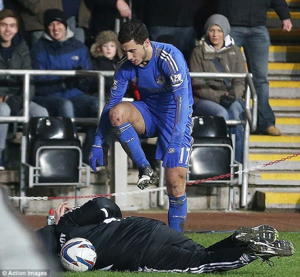 Eden Hazard having forcibly removed the ball from Morgan's clutches (Action Images)